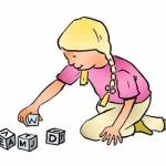 Meisje met letter blokken